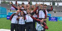 Foto: DSB / Das sehr erfolgreiche Recurve-Bogenteam feiert sich zurecht für die erzielten Ergebnisse.